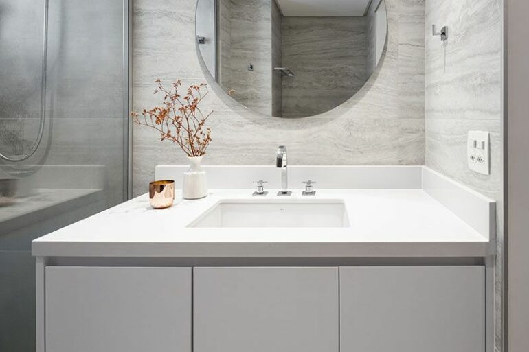 Gabinete para banheiro com cuba e espelh redondo - Via: Pinterest