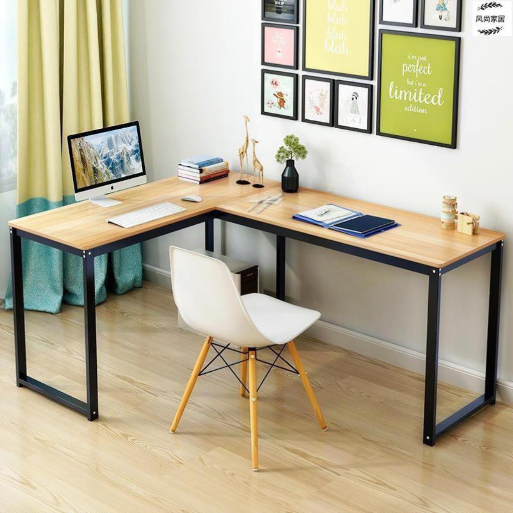 Mesa de escritório em L com quadros decorativos