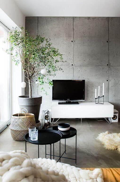 Sala de estar decorada com com revestimento de cimento queimado