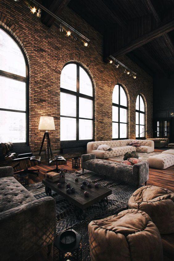Sala de estar no loft moderno com tijolinho a vista