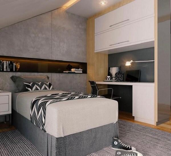 Decoração moderna com parede de cimento queimado e cama de viúva box