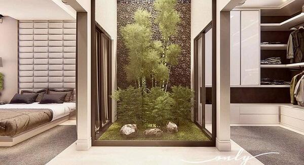 O jardim de inverno no quarto separa a cama do closet