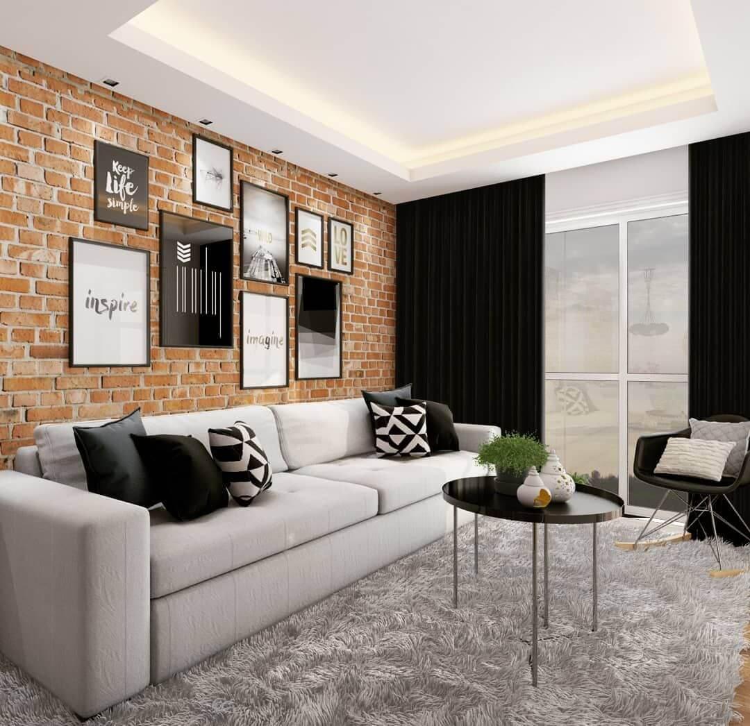Os tijolos para construção se destacam na decoração dessa sala de estar