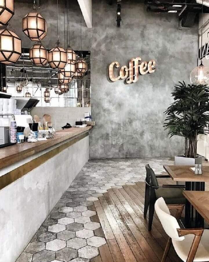 café com estilo industrial decorado com revestimento hexagonal no chão e cimento queimado Foto Simples Decoração