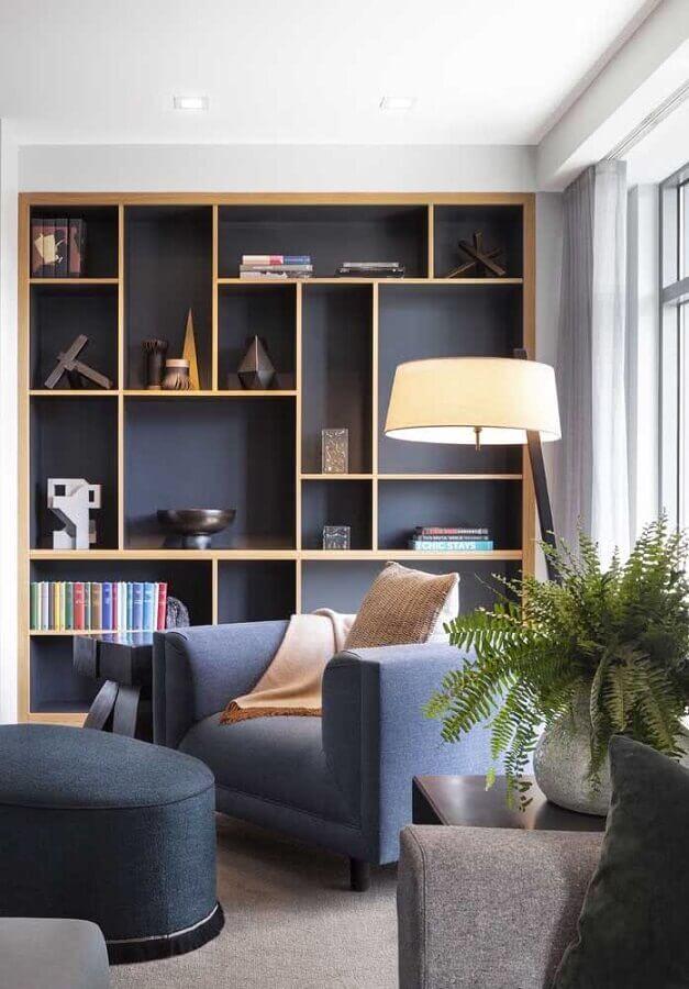 cantinho de leitura decorado com estante de nichos planejada Foto Architecture Art Designs
