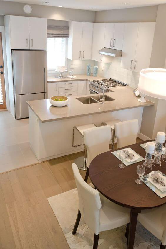 Cozinha americana integrada a sala de estar