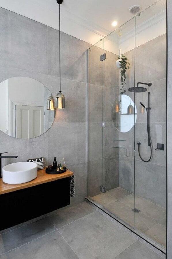 decoração clean com cimento queimado e espelho para banheiro redondo sem moldura Foto Futurist Architecture