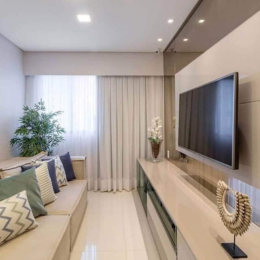 decoração com suporte para TV na parede de sala pequena Foto Behance