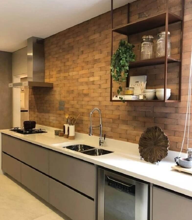 decoração de cozinha de apartamento planejada com parede de tijolinho Foto Carlos Rossi Arquitetura