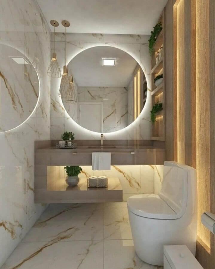 decoração sofisticada com espelho redondo para banheiro com iluminação embutida Foto OKA Arquitetura