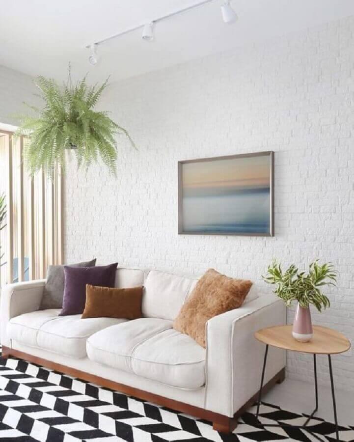 parede de tijolinho branco para decoração de sala clean com tapete preto e branco Foto Pinterest