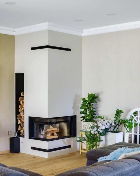 Sala moderna com lareira de canto a lenha