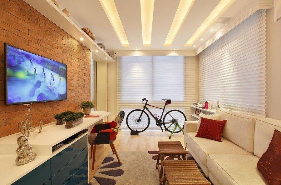 sala de estar decorada com tv na parede de tijolinho Foto Pinterest