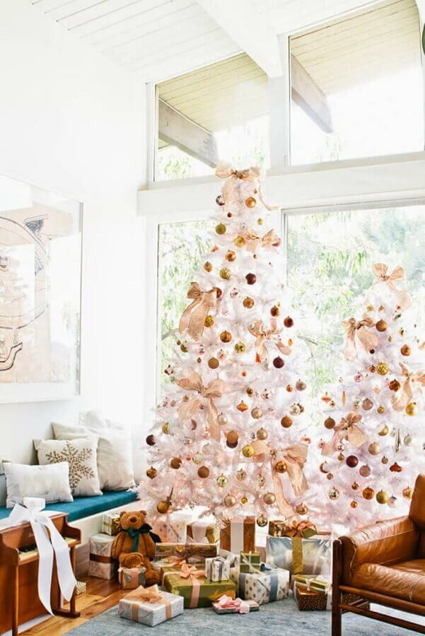 Large white Christmas tree decorated with golden balls Photo Demask & Dentelle