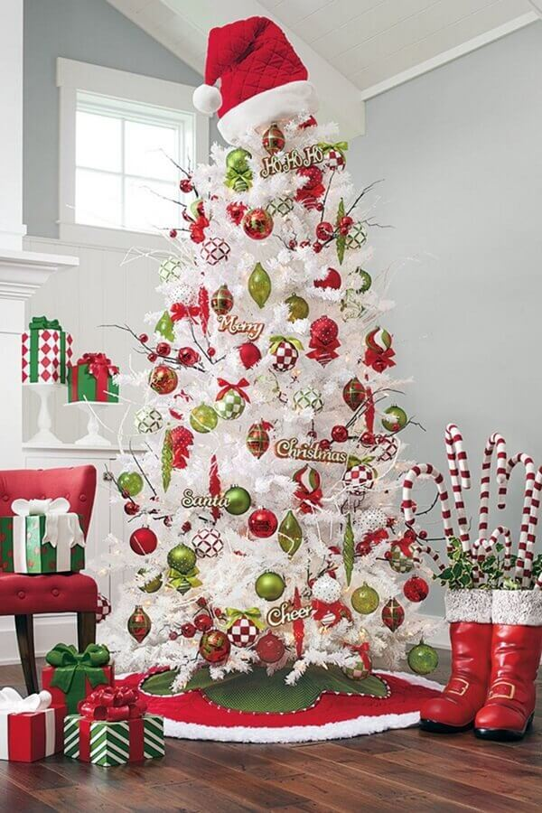 big white Christmas tree decorated with red and green balls Photo Pinterest