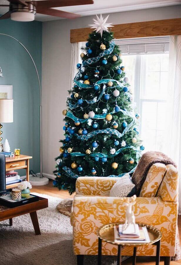 large christmas tree decorated with blue silver and gold ornaments Photo The Interior Designer