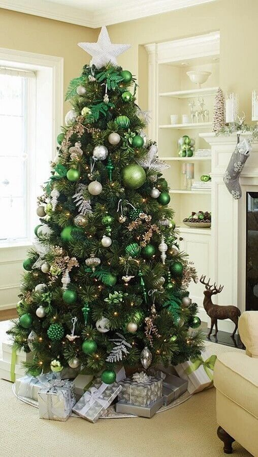 big Christmas tree decorated with green ornaments and silver Photo Pinterest