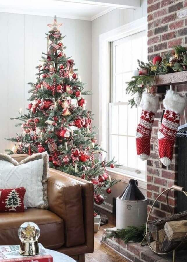 large christmas tree decorated for living room with leather sofa Photo Pinterest