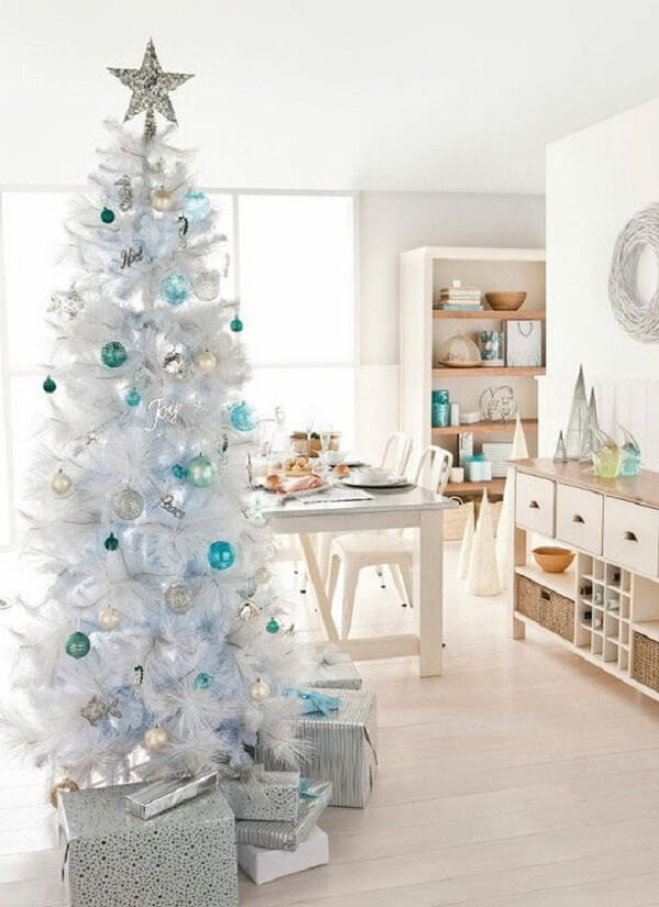 The white and blue Christmas tree connects with the clean decoration