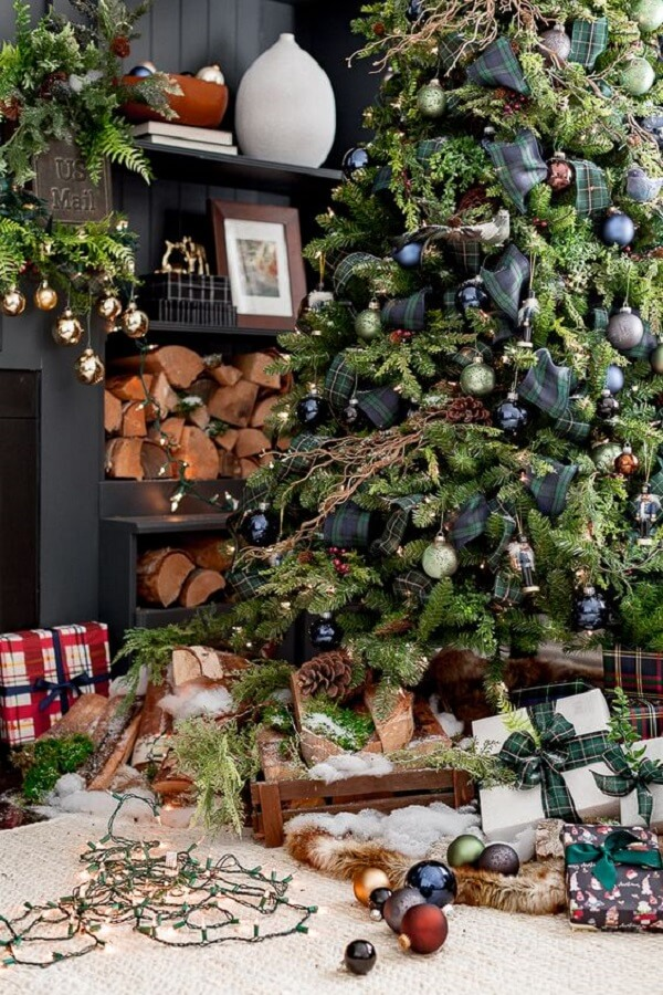The blue decorated Christmas tree adds charm and style to the atmosphere
