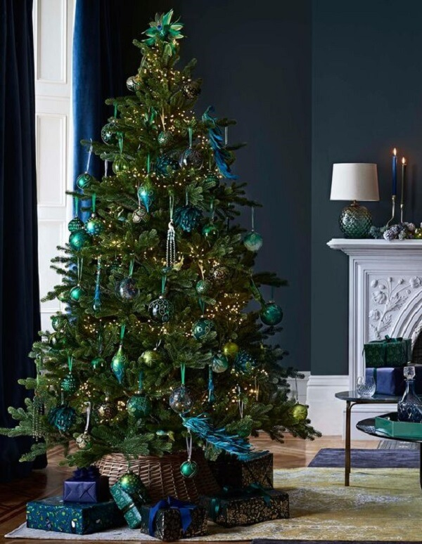 The blue decorated Christmas tree stands out in the living room