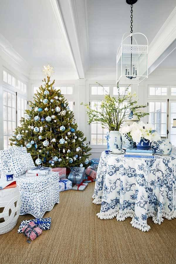 The blue decorated Christmas tree connects with the rest of the Christmas furniture and items