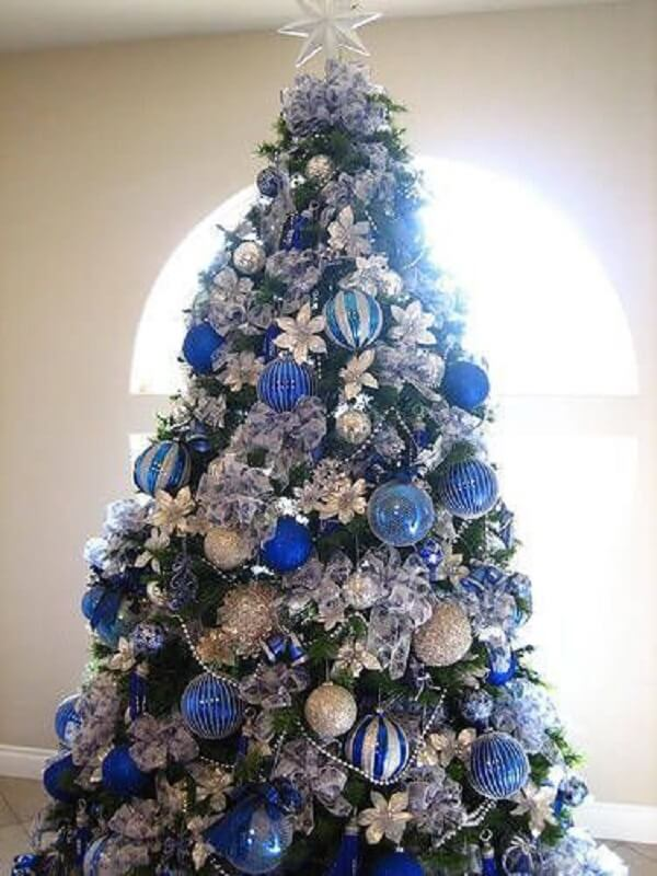 The majestic blue and silver Christmas tree was positioned next to the window