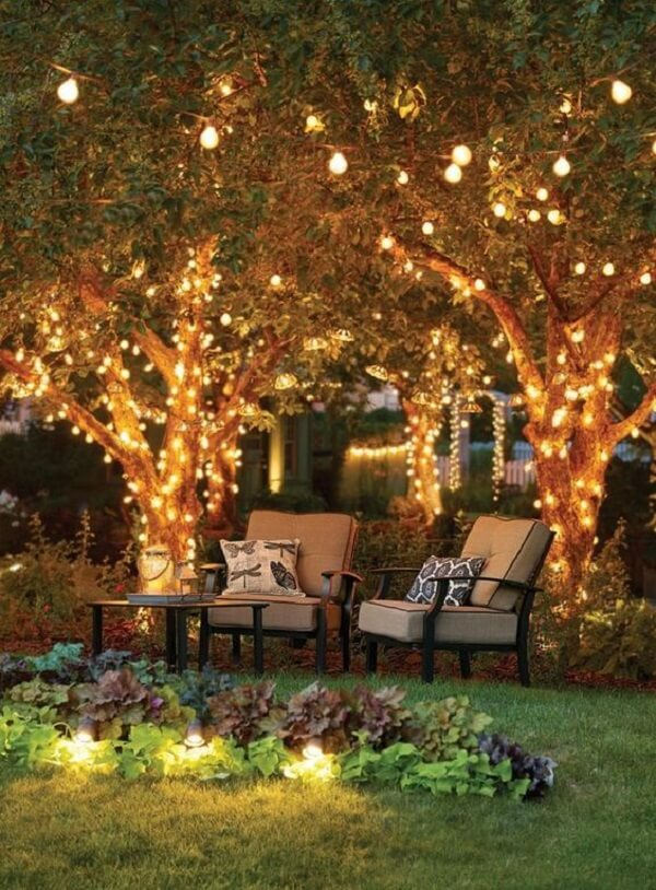 Lighted trees can't be lacking in Christmas garden decoration