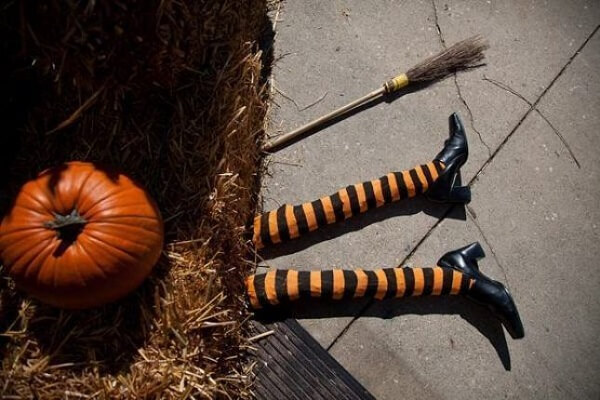 The witch's legs and the halloween pumpkin decorate the environment
