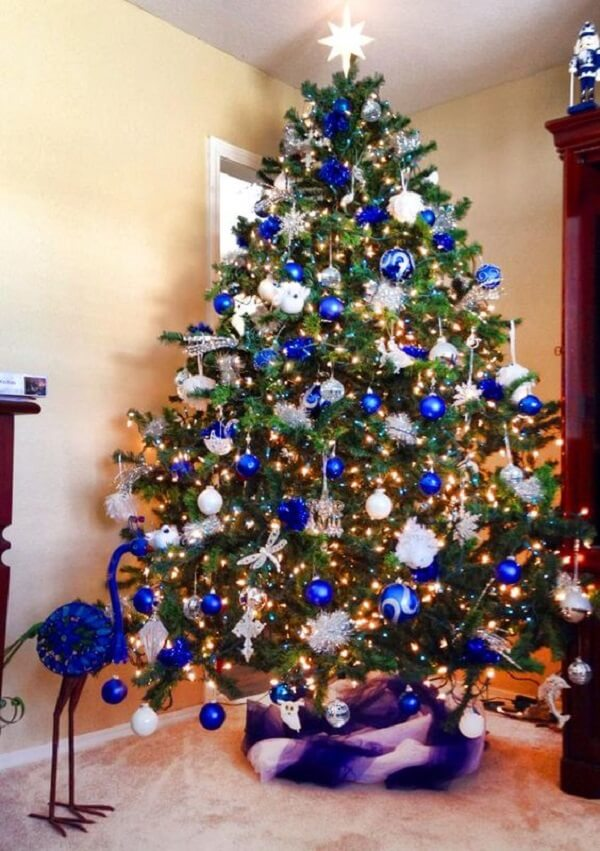 Evaluate the size of the blue Christmas tree before buying it
