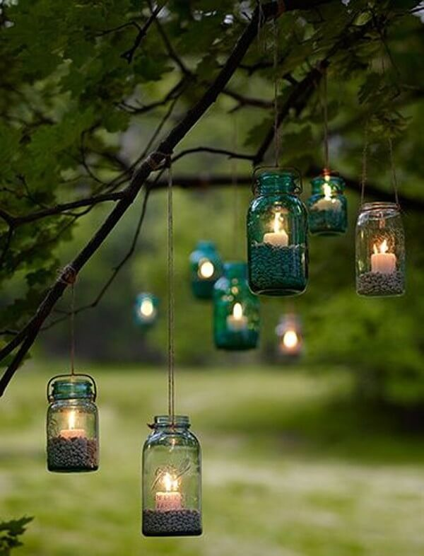 How to make garden Christmas decoration with glass jars and candles