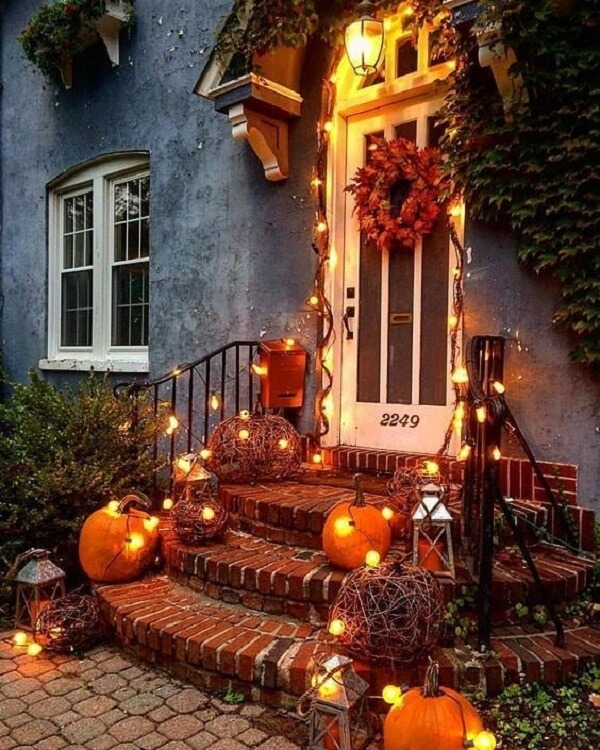 Decoration with halloween pumpkin and outdoor candles