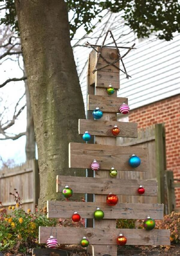 Simple and inexpensive Christmas garden decoration made with wooden tree and colored balls