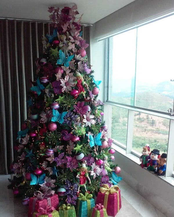 Escape the basics and invest in a Christmas tree with blue, pink and green decoration