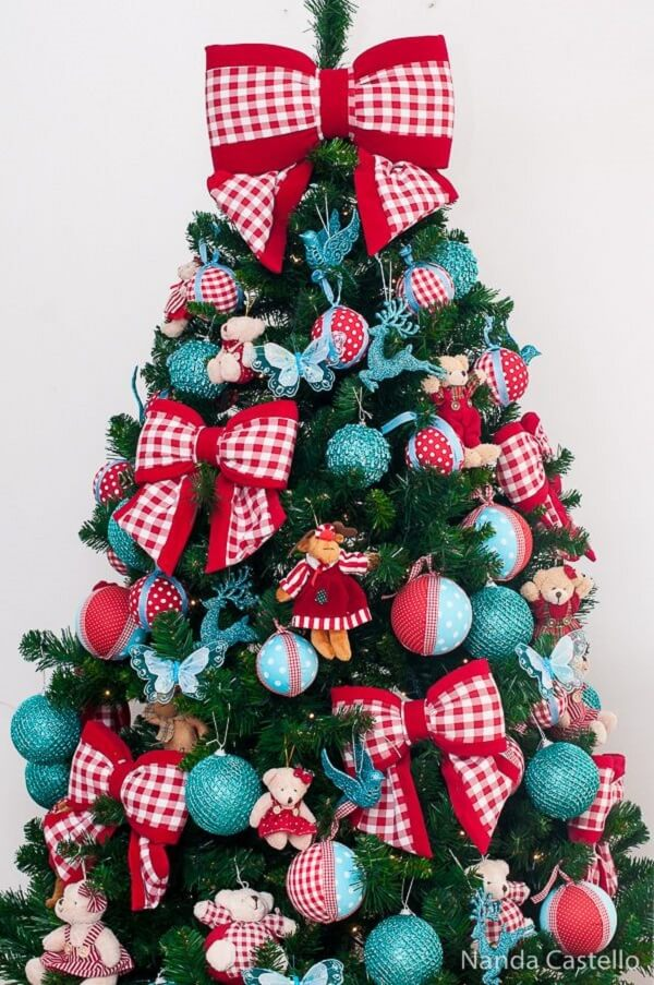 Ties and balls decorate the blue and red Christmas tree