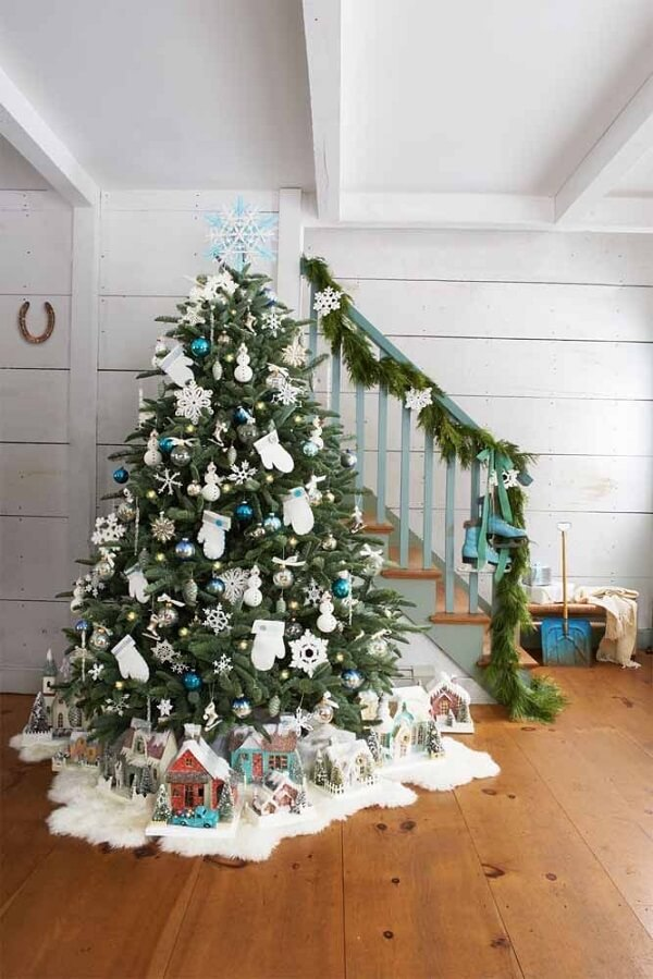Don't forget to include decorations on the feet of the Christmas tree with blue decoration