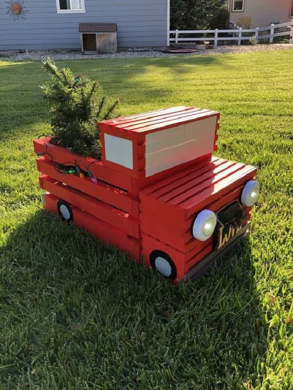 The wooden cart was used as Christmas decoration for outdoor garden