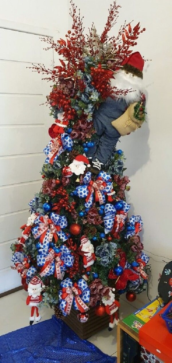 Santa was placed on the side of the blue and red Christmas tree
