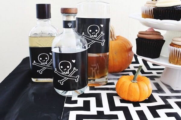 Customize bottle labels and use the Halloween pumpkin to complement the table decoration