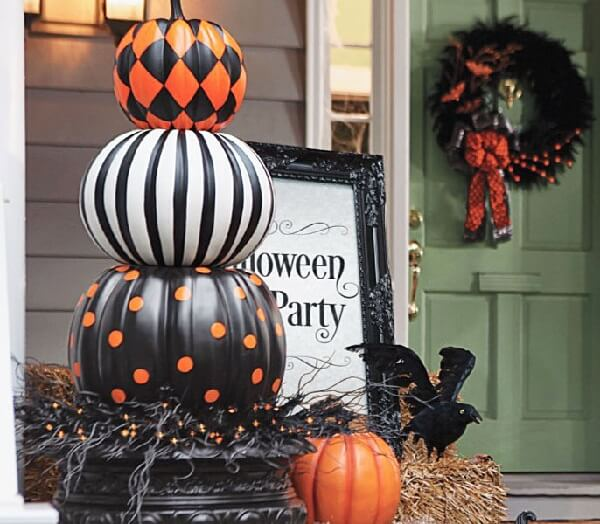 How about stacking the halloween pumpkin in the driveway?