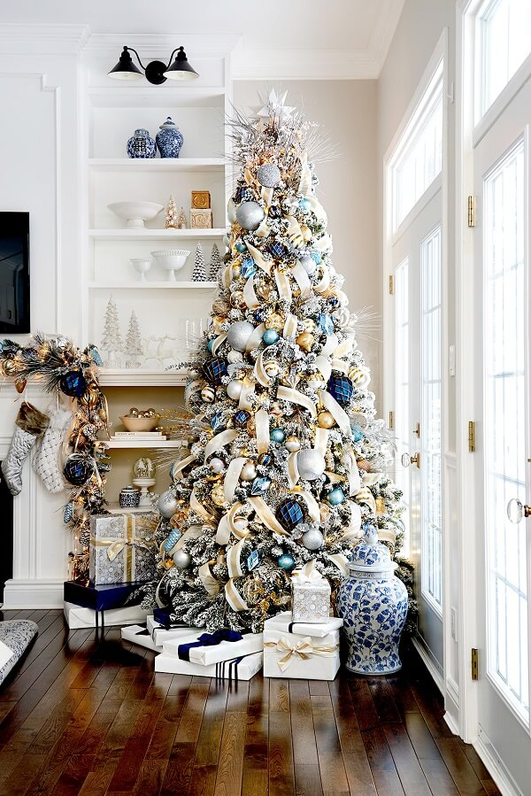 Several gifts were placed under the blue and gold Christmas tree