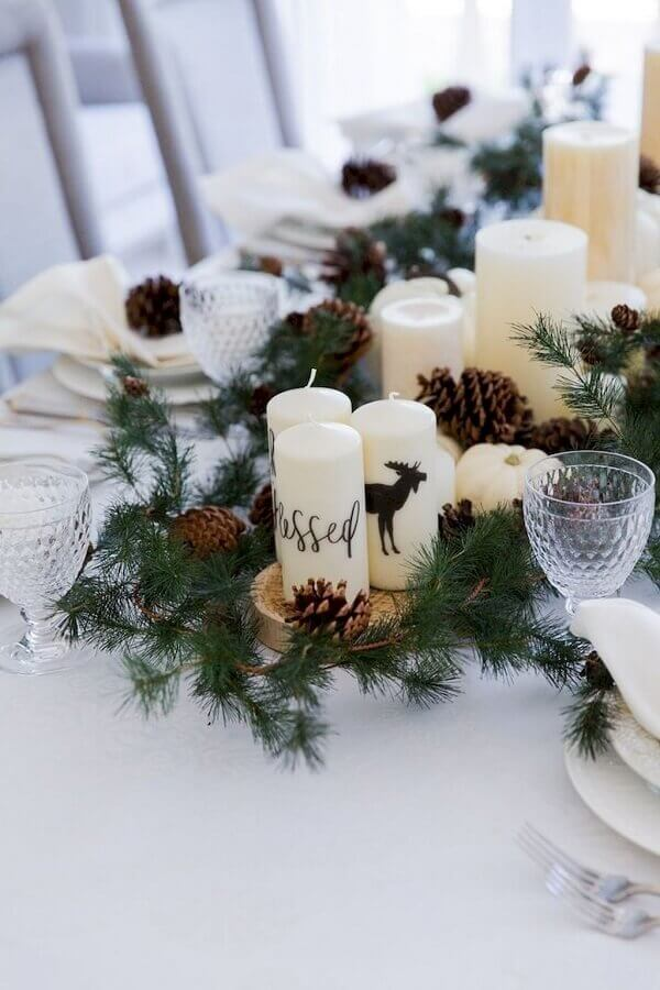 Christmas arrangement for table with pinecones and candles Photo Fashionable Hostess