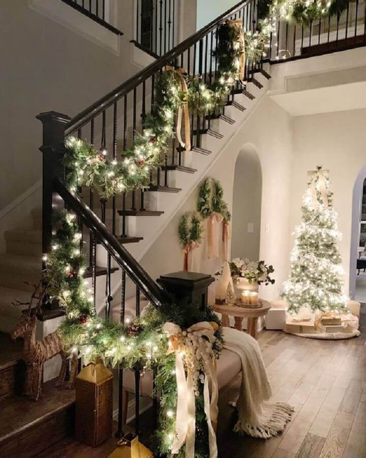 decoration with Christmas festoon and flashing for staircase Photo PopSugar