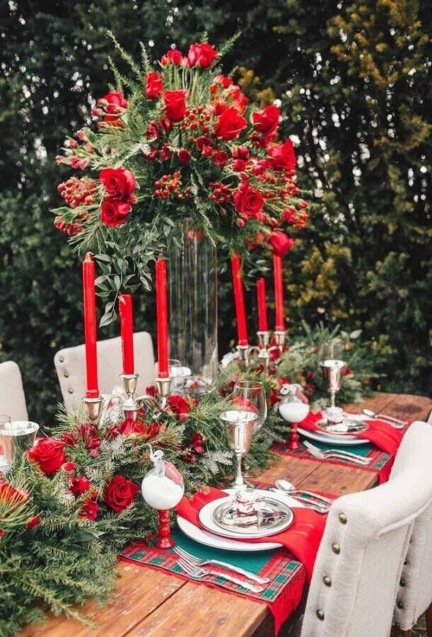 classic christmas table decoration with candles and red roses Photo Style Me Pretty