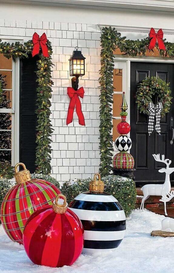Christmas decoration for outdoor area with red bow tie Photo Pinterest