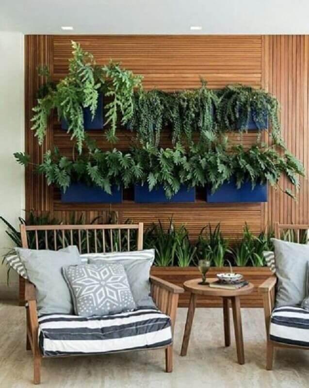 decoração moderna com plantas para varanda de apartamento com poltronas confortáveis Foto Pinterest