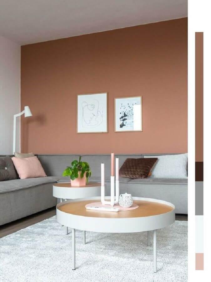 decoração tons terrosos para sala moderna com sofá de canto cinza Foto Pinterest