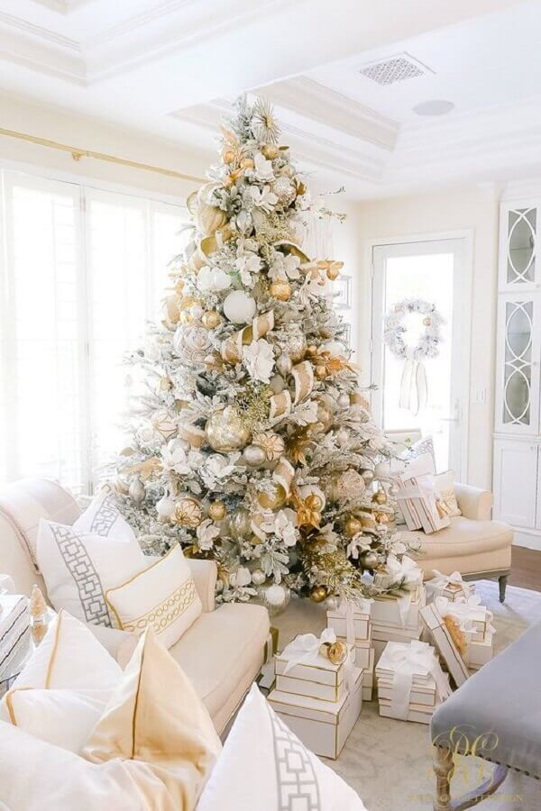 golden decorations for big white Christmas tree Photo Warehouse Home