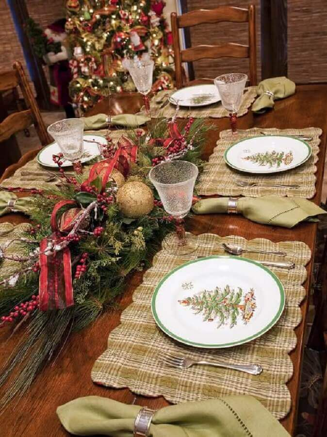 Christmas decorations for rustic table with plates decorated with Christmas tree painting Photo Dcore You