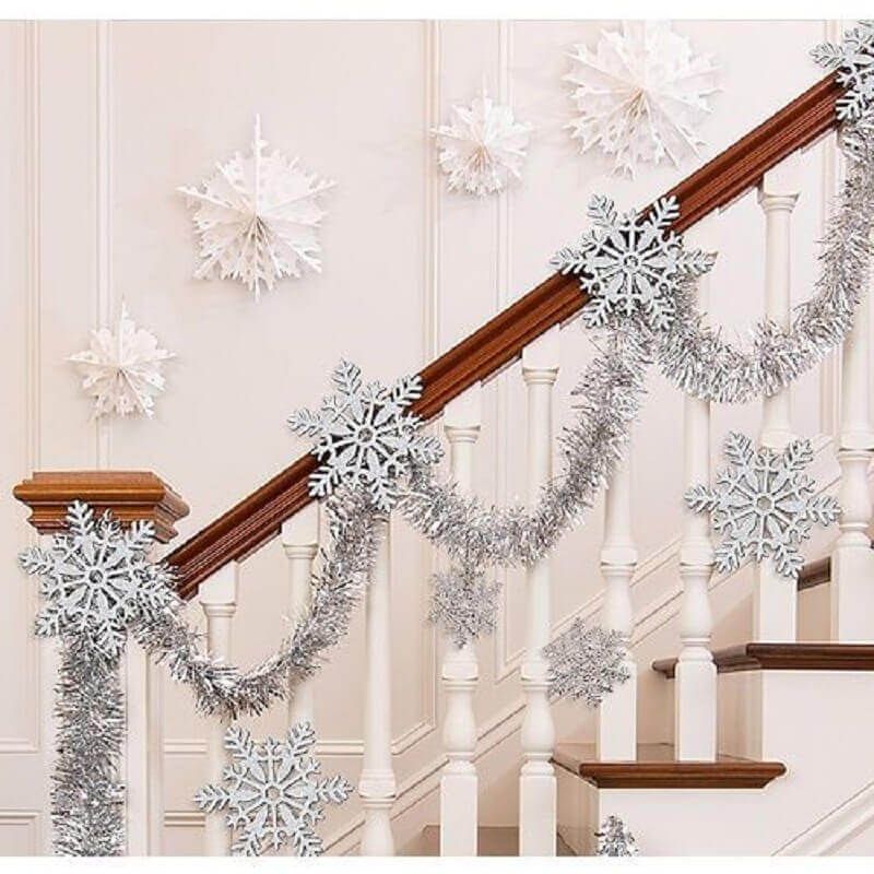 Staircase decorated with silver Christmas Party City